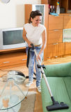 Woman hoovering apartment Stock Photos