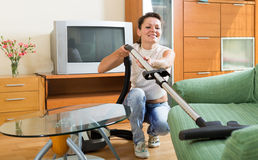Woman hoovering apartment Stock Images