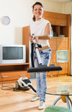 Woman hoovering apartment Stock Photo