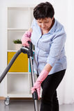 Woman during hoovering Stock Image