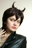 Woman with horns. Prettyb woman with pearls and horns Stock Photos