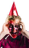 Woman with horror make up and party hat Royalty Free Stock Photography