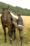 A woman and a horse. Royalty Free Stock Images