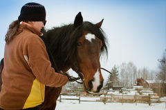 Woman with horse. On winter landscape background Stock Images