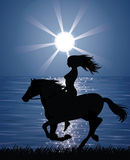 Woman and a horse. Royalty Free Stock Image
