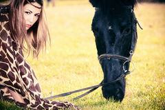 Woman and horse Stock Images