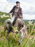 Woman on horse Stock Photography
