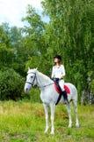Woman on horse Stock Photos