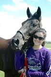 Woman and Horse. Young woman happy with the arrival of her new black horse Royalty Free Stock Images
