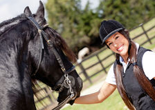 Woman with a horse Stock Image