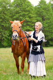 Woman with horse Stock Images