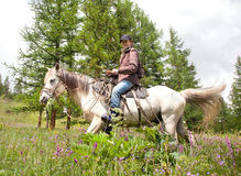 Woman on horse Stock Photo