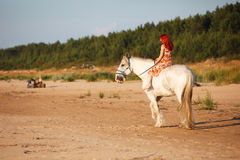 Woman with horse at the beach Stock Images