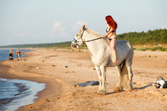 Woman with horse at the beach Royalty Free Stock Photos