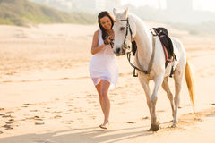Woman horse beach Stock Images