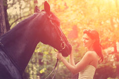 Woman and horse Stock Photography