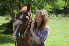 Woman with horse. A woman with a brown horse Stock Image