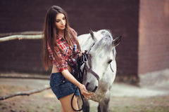 Woman and Horse. Casual Sexy Style Royalty Free Stock Photo