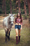 Woman and Horse. Casual Sexy Style Stock Images