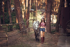 Woman and Horse. Casual Sexy Style Royalty Free Stock Photos