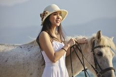 A woman with horse Stock Image
