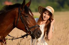 The woman on a horse in the field Stock Image