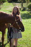 Woman with horse in field Stock Photography