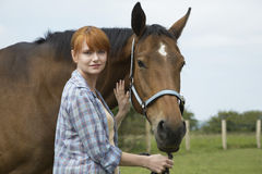 Woman With Horse In Field Royalty Free Stock Image