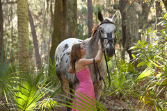 Woman and horse in forest Royalty Free Stock Photos