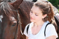 Woman with horse. Woman looking a horse during summer Royalty Free Stock Photo