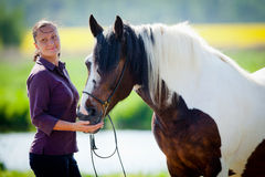 Woman and horse outdoor Royalty Free Stock Photo