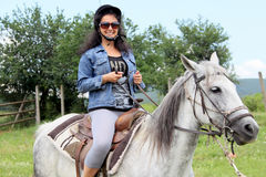 Woman on horse Stock Image