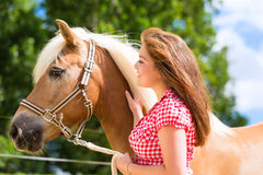 Woman with horse on pony farm Royalty Free Stock Photo