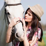 Woman and  horse. Portrait close up, pink plaid shirt Royalty Free Stock Photo