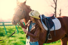 Woman and  horse. Portrait close up, sunset, smile Royalty Free Stock Photo