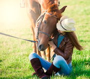 Woman and  horse. Portrait close up, sunset, smile Royalty Free Stock Photography