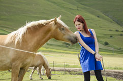 Woman with horse Stock Photography
