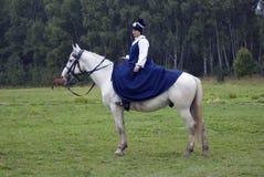 A woman horse rider at Borodino battle historical reenactment in Russia stock photo