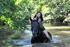 Woman and  horse in the river Royalty Free Stock Photo