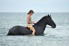 Woman and  horse in the sea Stock Photos