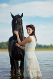 Woman on a horse by the sea Royalty Free Stock Photo