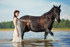 Woman on a horse by the sea Royalty Free Stock Images