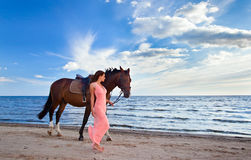 Woman with horse on seacoast Royalty Free Stock Photography