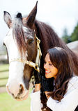 Woman with a horse smiling Royalty Free Stock Photography