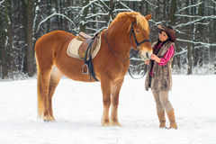 Woman with a Horse the Snow Royalty Free Stock Photos