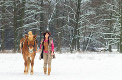 Woman with a Horse the Snow Stock Images