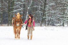 Woman with a Horse the Snow Stock Photography
