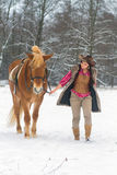 Woman with a Horse the Snow Royalty Free Stock Image