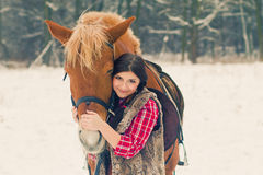 Woman with a Horse the Snow Royalty Free Stock Photo