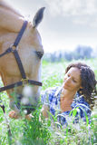 Woman and horse together Royalty Free Stock Photo